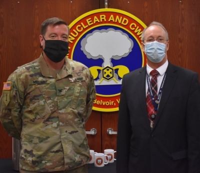 Col. Benjamin Miller, director of the U.S. Army Nuclear and Countering WMD Agency, met with Dr. Alan MacDougall, director of the National Counterproliferation Center, after MacDougall spoke on the importance of sustained counterproliferation education, training, and developing during a seminar at Ft. Belvoir, Virginia. (Photo provided by the U.S. Army Nuclear and Countering WMD Agency)